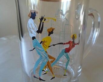 water/juice jug image of trumpet player ,couple dancing.