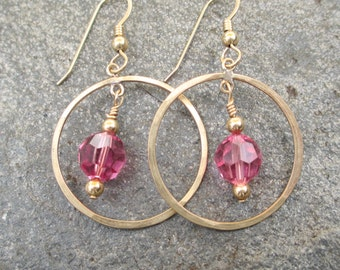 Lightly hammered gold filled rings with a pink Swarovski crystal dangling in the center