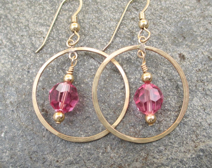handmade lightly hammered gold filled rings with a pink Swarovski crystal dangling in the center