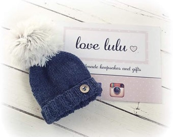 Hand knitted super pompom baby beanie