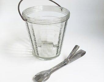 Vintage Glass ice bucket with ice tongs.