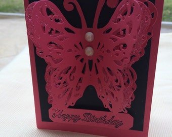 3-D butterfly birthday card with a very large pink butterfly and happy birthday greeting