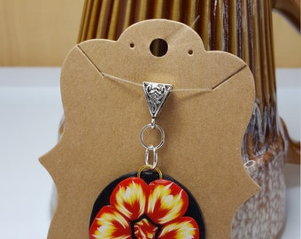 Polymer clay Fire flower pendant