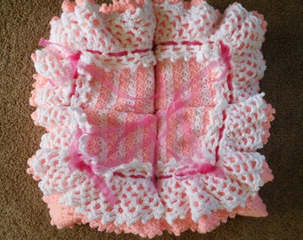 Beautiful pink and white striped Baby afghan