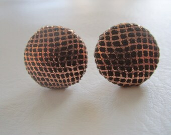 Brown and golden stud earrings