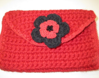 Hand crocheted Clutch bag in red and black with detachable flower brooch