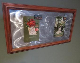 Framed magnet board with swirl design