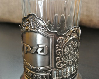 Tea cup glass holder. Emblem RZD, Russian Railways and faceted glass. In the style of the period of the Soviet Union. USSR