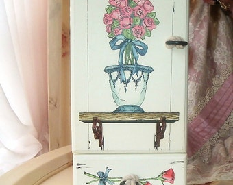 small storage cabinet with roses