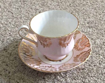 By Appointment to her Majesty the Queen Teacup & Saucer Set, Pink and gold filigree, Fruit, Flowers, Berries with Scalloped Edge