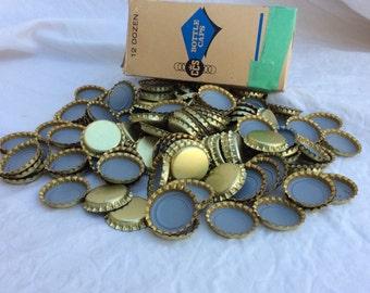 Mid century unused golden bottle caps. Lot of 144.