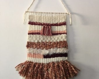 Coral, cream and plum woven loom wall hanging