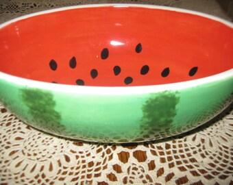 "Medium size watermelon or decorative bowl 9"" lg x 7"" wd x 4"" deep"