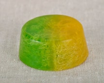 Soap with shower puff inside