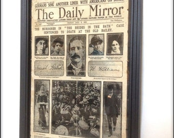 Reproduction Brides in the Bath 1915 newspaper cover in frame.