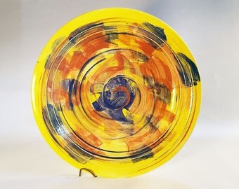 Yellow plate with multi-color design