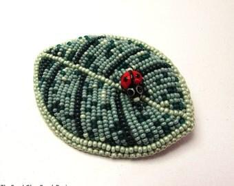 Ladybug on a leaf brooch