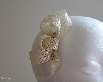 Small and simple cream fascinator, perfect for the races