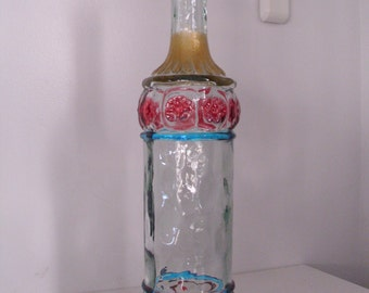 Decorative wine decanter with hand painted  raised design