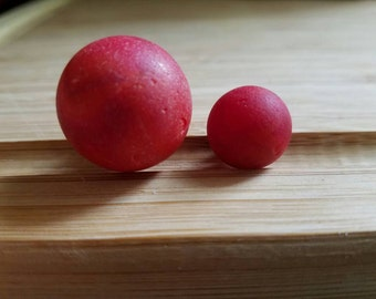 Large and small red Sea marbles.