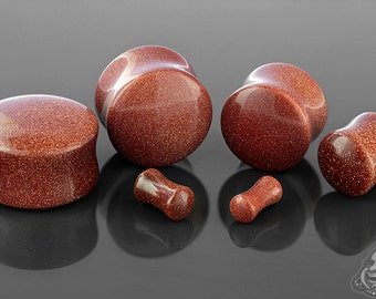 "Red Goldstone plugs 6g, 4g, 2g, 0g, 00g (9.5mm), 7/16"", 1/2"" (13mm), 9/16"", 5/8"", 3/4"", 7/8"", and 1"""