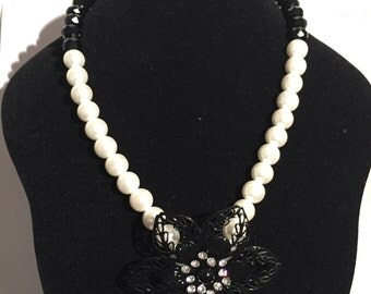 Black and White Pearl Necklace with Over-sized Floral Pendant Centered