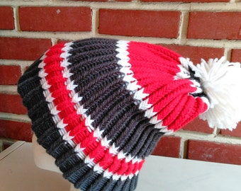 Red white and charcoal gray winter hat with pom pom
