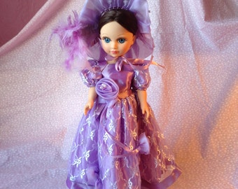 Vintage Doll In Hand Made Clothes