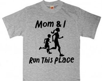 Child running shirt Mom and I run this place-boy
