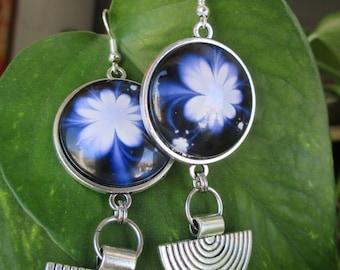 Silver earrings ethnic white flower background blue