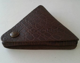 Triangle leather coin.