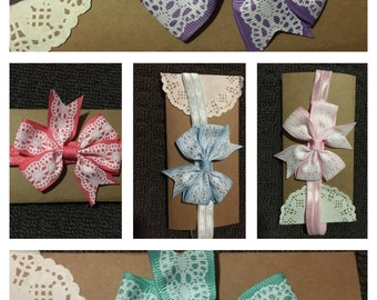 Lace Patterened Bow on elastic.