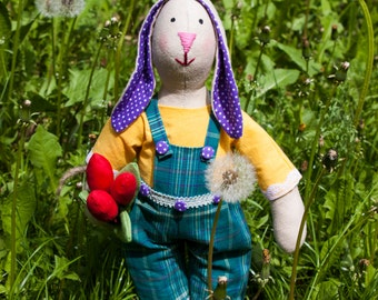 Spring Tilda hare with the bouquet of tulips. Hand Made.