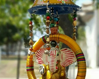 Ganesh hanging ornament. Folk art from india. Ganesh the elephant God is believed to remove obstacles and bring good luck and prosperity.