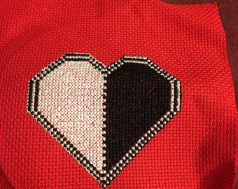 Black and white heart on red