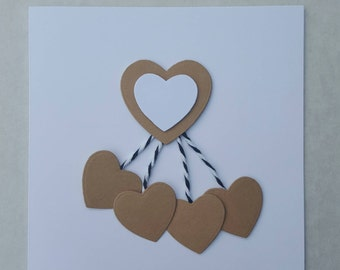 Handmade greetings card with hearts embellishments