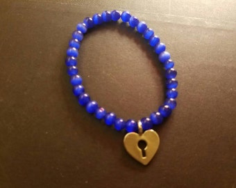 Handcrafted Purple Beaded Bracelet With Charm