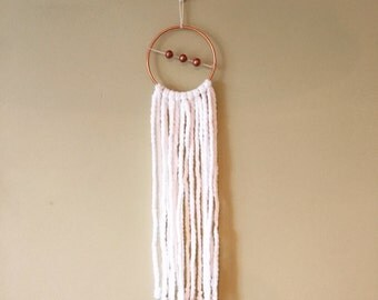 White yarn copper ring wall hanging