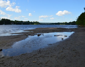 Photo of a beach of the St-Maurice River referring to calm