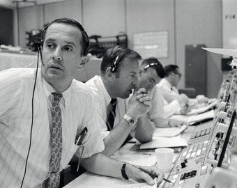 Capcom Charlie Duke With Jim Lovell & Fred Haise in Mission Control During the Apollo 11 Mission - 5X7, 8X10 or 11X14 NASA Photo (BB-757)