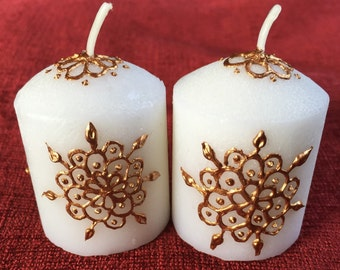 2 bronze henna design votive candles.
