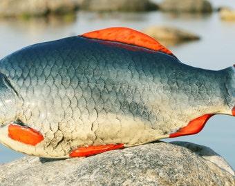 Ceramic fish - panels on the wall.
