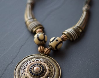 """Necklace """"Around the Om"""" metal, pearls and shells."""