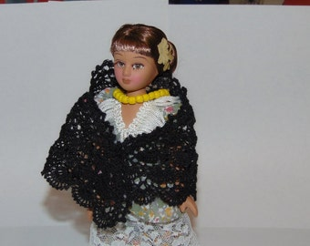 Knitted black scarf for dolls.