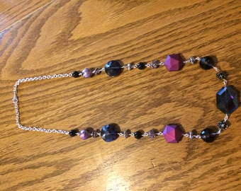 Handmade Silver Necklace with black, silver, and multicolored beads