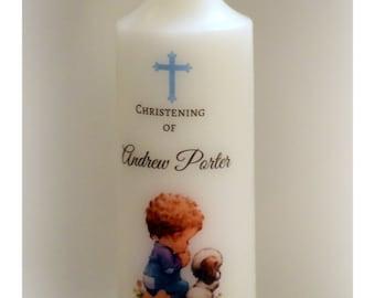 Little boy praying Baptism candle