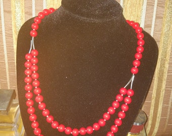 red coral beads on a thread of Kevlar