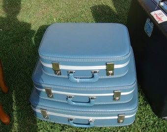 3 Blue hard case suitcases-fit into each other-pretty nice inside and out-Pick Up Only