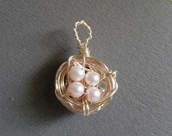 Bird nest charm