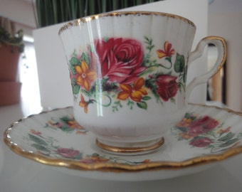 two floral argyle tea cups with saucers & two sandwich plates